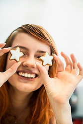 Close up of a red-haired young woman with cinnamon stars as eyes, Munich, Bavaria, Germany