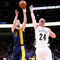 03 April 2018: Indiana Pacers center Domantas Sabonis (11) takes a jump shot over Denver Nuggets center Mason Plumlee (24) during the Denver Nuggets 107-104 victory over the Indiana Pacers, at the Pepsi Center, Denver, Colorado, USA.