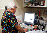 Vet's Clinic, for pets and small animals. Veterinary surgeon in his office. Model and property releases available