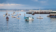 Calm water under cloudy skies in Monterey harbour in California