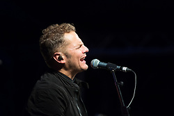 "@Licensed to London News Pictures 10/09/17. Lead singer of Toploader, Joseph Washbourn, performs  their most recognised hit ""Dancing in the Moonlight"" at the Hop & Harvest Festival in Maidstone in Kent.  Photo credit: Manu Palomeque/LNP"