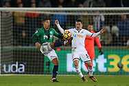 Jake Livermore of West Bromwich Albion gets to the ball ahead of Roque Mesa of Swansea city. Premier league match, Swansea city v West Bromwich Albion at the Liberty Stadium in Swansea, South Wales on Saturday 9th December 2017.<br /> pic by  Andrew Orchard, Andrew Orchard sports photography.