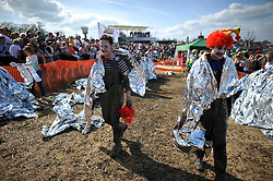 © London News Pictures. 05/05/2013. Maldon, UK. Competitors wrapped in covers at the end of the Maldon Mud Race in Maldon, Essex on May 05, 2013. The race originated in 1973 and involves competitors racing around a course on the mudbanks of the river Blackwater at low tide. Photo credit: Ben Cawthra/LNP.