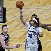 ORLANDO, FL - APRIL 12: Cole Anthony #50 of the Orlando Magic attempts a shot past Rudy Gay #22 of the San Antonio Spurs during the second half at Amway Center on April 12, 2021 in Orlando, Florida. NOTE TO USER: User expressly acknowledges and agrees that, by downloading and or using this photograph, User is consenting to the terms and conditions of the Getty Images License Agreement. (Photo by Alex Menendez/Getty Images)*** Local Caption *** Cole Anthony; Rudy Gay