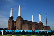 Battersea Power Station in South London. This classic Art Deco brick design with it's distinctive four white towers is one of London's most famous landmarks. Now derelict and with plans for possible development, it remains one of the iconic designs which towers over the River Thames.