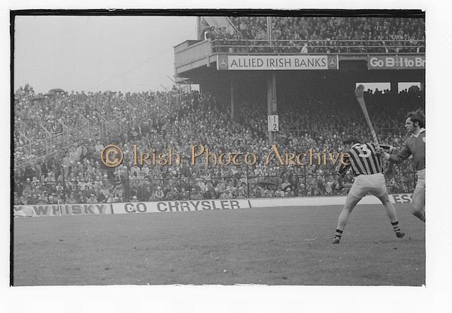 Kilkenny player about to hit the slitor during the All Ireland Senior Hurling Final Limerick v Kilkenny at Croke Park on the 2nd September 1973. Limerick 1-21 Kilkenny 1-14.