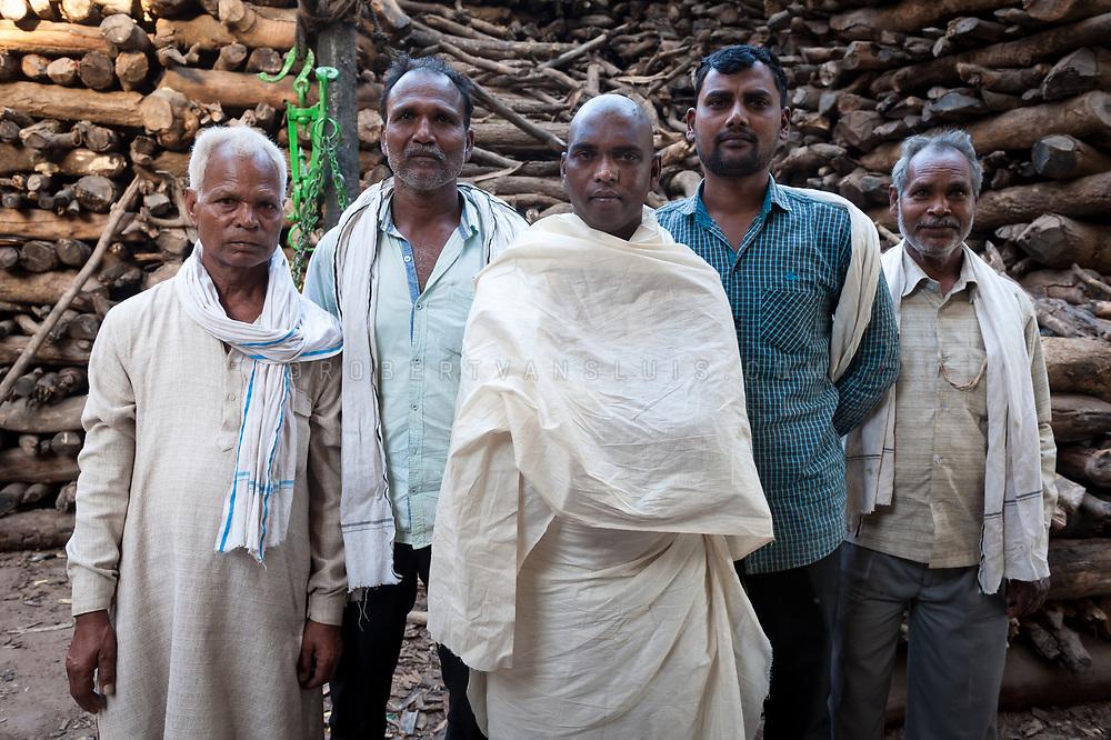 A family after a cremation at Manikarnika cremation ground, Varanasi, India. Photo © robertvansluis.com