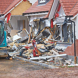 © Licensed to London News Pictures. 13/08/2018. Buntingford, UK.  General view of the scene in Ermine Street after a man demolished at least six nearly finished McCarthy and Stone houses using a digger on Saturday. Police have charged builder Daniel Neagu, 30, with criminal damage. Photo credit: Cliff Hide/LNP