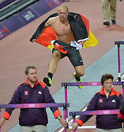 Germany's Robert Harting takes a victory lap after winning the Gold Medal in the Men's Discus Throw at the London 2012 Summer Olympics on August 7, 2012 in Stratford, London. Harting won with a throw of 68.27M.  (UPI)