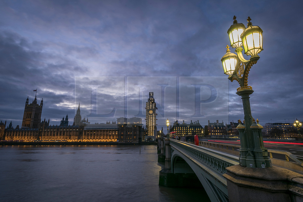 © Licensed to London News Pictures. 14/01/2019. LONDON, UK.  Dusk arrives behind the Houses of Parliament.  Theresa May is currently delivering a speech to MPs in the House of Commons, urging them to back her EU Brexit deal when they vote on it on 15 January.  Photo credit: Stephen Chung/LNP
