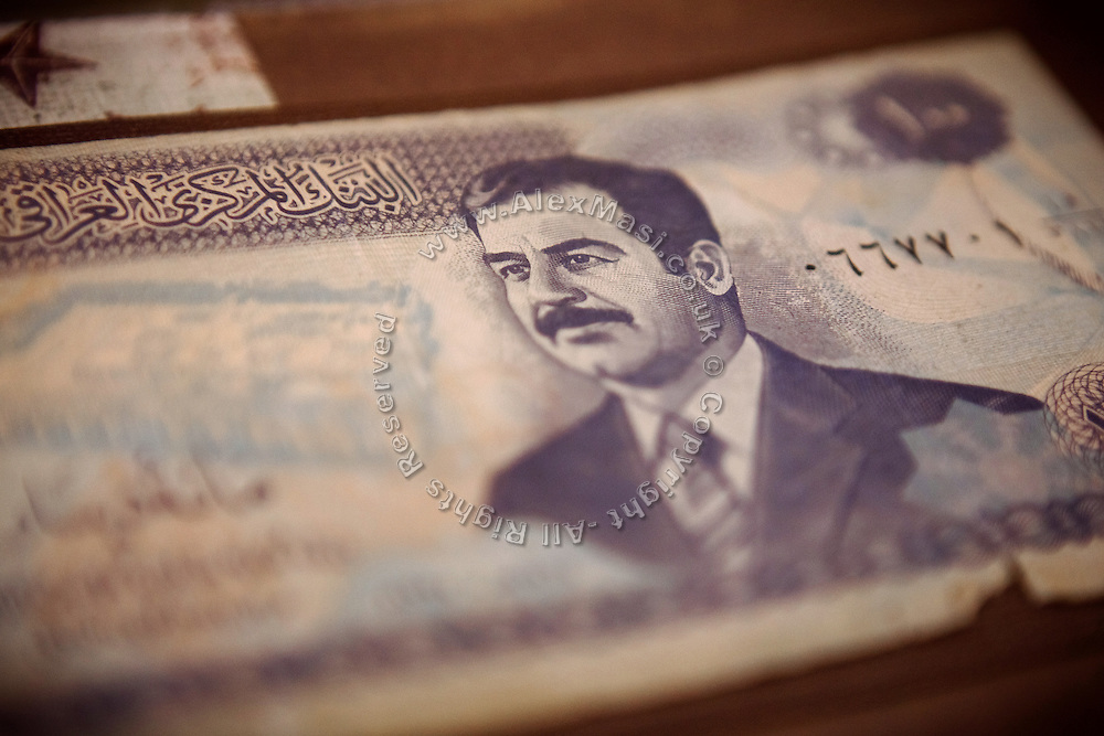 An old Iraqi note with the image of Saddam Hussein, is part of the album the wife of Benjamin Tippetts, 27, prepared for him after he left the Army, in their home in La Crosse, WI, USA. He now works as a freelance financial advisor and lives with his wife and newborn daughter. Benjamin has been an Army infantryman in Fallujah, fighting in the 2nd battle in 2004.