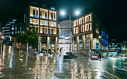 Exterior view at night of new St James Quarter shopping and entertainment centre in Edinburgh, Scotland, UK