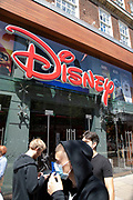 Face masks outside the Disney store as the Coronavirus lockdown measures are set to ease further, the west end starts to fill with people as they return to the shopping district on Oxford Street and the quiet city starts coming to an end on 22nd June 2020 in London, England, United Kingdom. As of today the government has relaxed its lockdown rules, and is allowing some non-essential shops to open with individual shops setting up social distancing queueing systems.