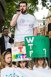 London, UK. 30 May, 2019. Max Green, actor, Autistic Ambassador for the National Autism Society and YouTuber, addresses campaigners from SEND National Crisis attending a demonstration in Parliament Square to demand improvements in the diagnosis and assessment of young people with SEND, assistance for their families, funding and legal and financial accountability for local authorities in their treatment of young people with SEND and their families.