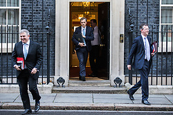 © Licensed to London News Pictures. 28/11/2017. London, UK. Home Office Minister Brandon Lewis (L), Conservative Chief Whip Julian Smith (C) and Attorney General Jeremy Wright (R) leave 10 Downing Street after the weekly Cabinet meeting. Photo credit: Rob Pinney/LNP