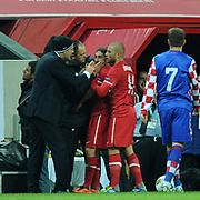 Turkey's Sabri SARIOGLU (C) and Croatia's coach Slaven BILIC (L) during their UEFA EURO 2012 Play-off for Final Tournament First leg soccer match Turkey betwen Croatia at TT Arena in Istanbul Nüovember11, 2011. Photo by TURKPIX