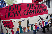 London, UK. Saturday 18th May 2013. Banner reads: Fight austerity, fight capitalism. Demonstration against NHS reform and proposed funding cuts for services within the National Health Service.