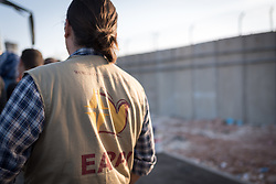 8 October 2018, Jerusalem, Occupied Palestinian Territories: EAs monitor and document the situation at many checkpoints in Jerusalem and the West Bank, and offer basic support if anyone is denied passage, by asking to find out the reason given for the denial, and providing contact details to organizations – international, Palestinian, and Israeli ones – that can give practical support as necessary. Qalandiya is the main checkpoint between the northern West Bank and Jerusalem, where thousands upon thousands of Palestinians try to make their way to Jerusalem each day. Ecumenical accompaniers (EAs) from the World Council of Churches' Ecumenical Accompaniment Programme in Palestine and Israel (WCC-EAPPI) visit regularly in the early mornings. Their task is to be an international presence and to show solidarity, offer basic support to anyone denied passage, and collect documentation of the situation at the checkpoint. EAs' reports feed into the UN system, providing ongoing monitoring of the human rights situation in Israel and Palestine.