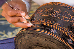 Asia, Myanmar, Bagan, Htilominlo Temple, hand applying metal filigree to lacquerware