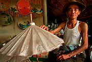 THAILAND, NORTH, GOLDEN TRIANGLE Chiang Mai, workshop making traditional hand-painted paper umbrellas