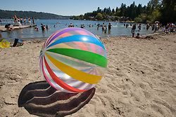 United States, Washington, Redmond, ball on beach at Idylwood Park on Lake Sammamish