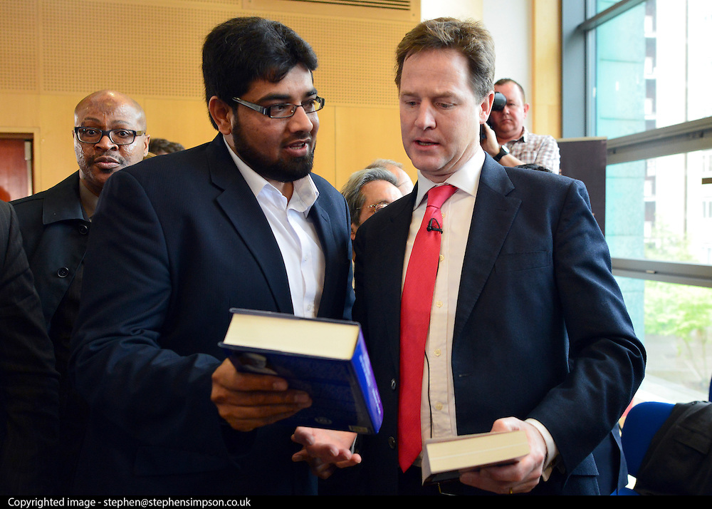 """© Licensed to London News Pictures. 24/05/2013. London, UK Nick Clegg is handed books a the meeting by a member of the audience. one of the books was titled """"FATWA on Terrorism and Suicide Bombings """". Nick Clegg, Liberal Democrat MP and Deputy Prime Minister, attends a multi faith gathering with the local multi faith community at the Hugh Cubitt Peabody Centre in Islington London today 24th May 2013. After meeting privately with political and faith leaders he and they made speeches in response to the attack and death of Drummer Lee Rigby in Woolwich, calling for the community to unite against the attack. Photo credit : Stephen Simpson/LNP"""