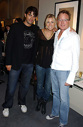 Left to right, STEPHEN SOLAKA,  fiance NICOLE KING and musician MICHAEL GLEASON at a private view of fashion designer Lindka Cierach's Couture Dresses drawn by Trudy Good held at the Belgravia Gallery, 45 Albemarle Street, London on 21st September 2005.<br />