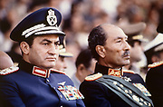 President Anwar Sadat of Egypt with Vice president Hosni Mubarak at the military review on the day of President Sadat's assassination. October 1981