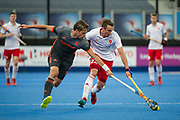England's David Condon is tackled by Bjorn Kellerman of the Netherlands. England v The Netherlands - Semi Final - Hockey World League Semi Final, Lee Valley Hockey and Tennis Centre, London, United Kingdom on 24 June 2017. Photo: Simon Parker