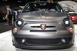 08  February 2013: 2013 Fiat 500 Abarth, 1.4L 16v multi air turbocharged engine car. Chicago Auto Show, Chicago Automobile Trade Association (CATA), McCormick Place, Chicago Illinois<br /> <br /> 2013 FIAT 500/500c: With Italian styling and American ingenuity, the 2013 Fiat 500 subcompact is offered as a two-door hatchback or as the 500c (cabrio/convertible), both with a Multiair 101 horsepower 1.4 liter four-cylinder engine. Retractable soft top operable at speeds up to 60 miles per hour with unprecedented three-position top design. This year, the model lineup includes the Fiat 500 and 500c Pop, Sport and Lounge editions. The Pop and Sport have a five-speed manual gearbox, while the six-speed automatic is optional but standard on the Lounge. The available safety features include traction control, antiskid system, ABS, front- and rear-side airbags, curtain-side airbags, and driver-knee airbag. Other standard features include air conditioning, power windows/locks/mirrors, and cruise control. The Sport versions have specific exhaust tuning, sport suspension, and exclusive interior and exterior trim. Lounge hatchbacks are designed with a fixed-glass roof, and a sunroof is optional on all hatchbacks. The wireless cell phone link is standard on all models however, except the Pop hatchback. Lounge and Sport models have optional heated front seats and come with the automatic transmission. Leather upholstery is only offered in the Lounge. The rear obstacle detection comes customary in all models besides the Lounge hatchback where it is optional. There are 14 exterior colors, 12 unique seat color combinations, three soft top color options and over 500,000 ways to customize your vehicle using Mopar accessories.