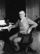 (Thomas) Woodrow Wilson (1856-1924) 28th President of the United States of America 1913-1921 throughout the First World War.  Suffered a severe stroke in October 1919 leaving him partially incapacitated.  Woodrow at his desk.