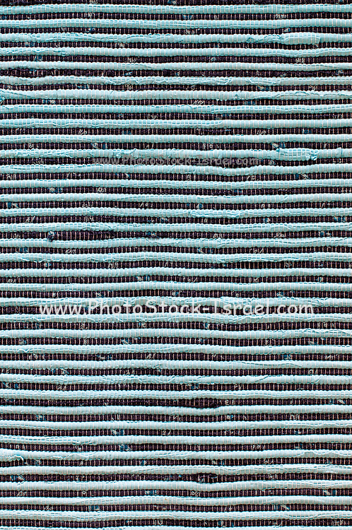 Closeup of woven mesh textile background with even spaced warp and woof threads