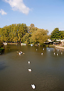 Boats on the River Thames in autumn at Lechlade on Thames, Gloucestershire, England, UK