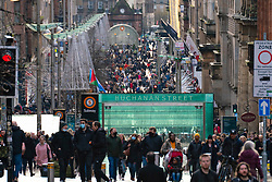Glasgow, Scotland, UK. 12 December 2020. On first day after Glasgow lockdown reduced to level 3 , shops in city centre are open and many Christmas shoppers are seen on the streets. Buchanan Street and Argyle Street are particularly busy.   Iain Masterton/Alamy Live News