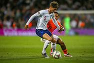 England defender John Stones (Manchester City) holds off Netherlands forward Memphis Depay (Lyon) during the UEFA Nations League semi-final match between Netherlands and England at Estadio D. Afonso Henriques, Guimaraes, Portugal on 6 June 2019.