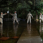 Members of Alpha Company, 1st Battalion, 118th Infantry Regiment, unload sandbags to help a local resident protect their property Oct. 9, in Parkers Ferry, S.C. (U.S. Air Force photo by Staff Sgt. Perry Aston/Released)