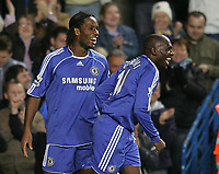 Photo: Lee Earle.<br /> Chelsea v Watford. The Barclays Premiership. 11/11/2006. Chelsea's Didier Drogba (L) celebrates with Geremi after he scored a hat-trick.