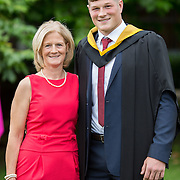 """24.08.2016        <br /> Over 300 students graduated from the Faculty of Science and Engineering at the University of Limerick today. <br /> <br /> Munster rugby player Jack O'Donoghue, Woodstown Co. Waterford was conferred with a Bachelor of Science in Pharmaceutical and Industrial Chemistry at the conferring ceremony. Jack is pictured with his mother, Caroline O'Donoghue. Picture: Alan Place.<br /> <br /> As the University of Limerick commences four days of conferring ceremonies which will see 2568 students graduate, including 50 PhD graduates, UL President, Professor Don Barry highlighted the continued demand for UL graduates by employers; """"Traditionally UL's Graduate Employment figures trend well above the national average. Despite the challenging environment, UL's graduate employment rate for 2015 primary degree-holders is now 14% higher than the HEA's most recently-available national average figure which is 58% for 2014"""". The survey of UL's 2015 graduates showed that 92% are either employed or pursuing further study."""" Picture: Alan Place"""
