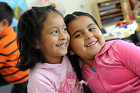 Tiny Tots Playschool participants Sophia Silva Huitron, left, and Briselda Quintana are having a great time on Tuesday morning at the Hebbron Family Center in Salinas.