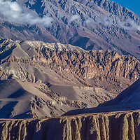 Eroded, rain-shadowed hills stretch north of the Annapurna massif at the edge of Mustang, Nepal.