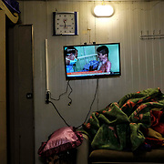 SHAILA, IRAQ - OCTOBER 19: Kurdish news plays scenes of a Syrian boy burned as a result from ongoing shelling due to the Turkish incursion into Rojava in at Peshmerga military medical center on October 19, 2019 in Shaila, Iraq. (Photo by Byron Smith/Getty Images)