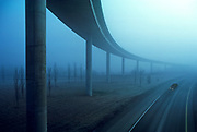Image of an elevated ramp and car in fog in Washington state, Pacific Northwest by Randy Wells