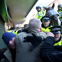 Members of the English Defence League (EDL) protest in Preston, England on November 27, 2010. Approximately 1,000 protestors assembled for the rally.  Numerous arrests were made in Preston's largest ever policing operation.  Counter-protest demonstrations by Unite Against Facism (UAF) took place nearby.