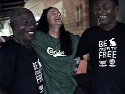 March 3, 2016 - Charlesville, Liberia - ''Those chimps are living things. They are us,'' says JOSEPH THOMAS (left).  JENNY DESMOND shares a moment of joy with the African caregivers on March 3, 2016 in Liberia, West Africa at the Liberian Chimpanzee Rescue base, a project of HSUS.  Members were extremely grateful for the help.  Humane Society of the United States and New York Blood Center came to an agreement recently in May 2017 after years of discussion about the care of research chimps NYBC had abandoned when they withdrew all funding for food and water when they retired the chimps.  Initially former caregivers used their own meager finances to continue feeding them.  They now live on six mangrove islands serving as a sanctuary run by Jenny and James Desmond.  The chimpanzees were literally left to die if not for the heroic efforts of their original caregivers who had worked for New York Blood Center and were abandoned as well. (Credit Image: © Carol Guzy via ZUMA Wire)