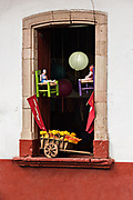 A shop window decorated with crafts in Santa Clara del Cobre, Michoacan, Mexico.