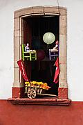 A shop window decorated with crafts in Santa Clara del Cobre, Michoacan, Mexico.