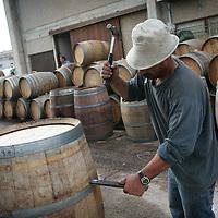 SETTLER'S BOUTIQUE WINE 2009...A Palestinian worker during renovation of barrels of Tanya boutique winery, during renovation of wine barrels in the West Bank Jewish settlement of Ofra, October 2009.