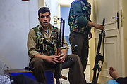 A member of the Free Syrian Army (FSA) sit next door at an FSA facility after his guarding shift was over at the FSA military checkpoint in Marea on Monday, June 25, 2012. (Photo by Vudi Xhymshiti)