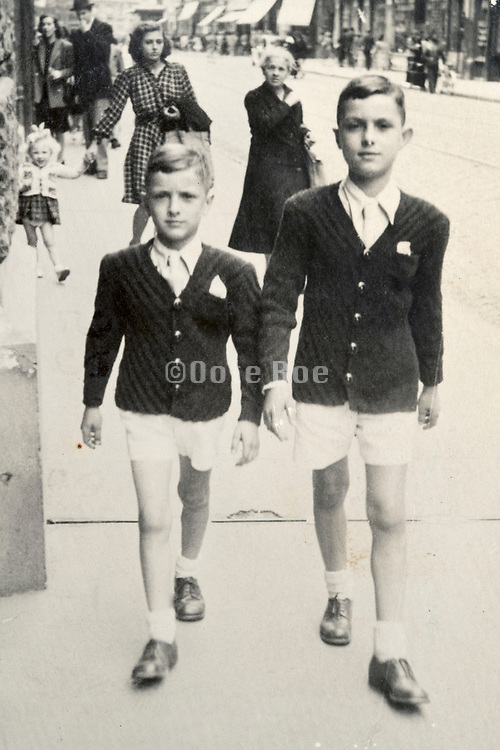 two fashionable dressed boys walking in the street France ca 1950s