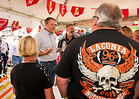 Governor Chris Sununu is welcomed by patrons at the Naswa Beach Bar to celebrate the 96th running of Laconia's Motorcycle Week Rally.  (Karen Bobotas/for the Laconia Daily Sun)